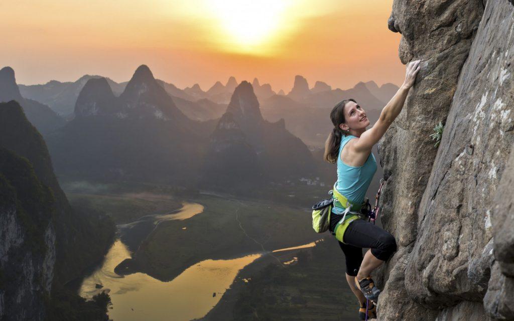 woman-climbing-tall-mountain