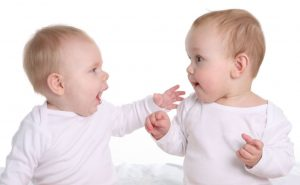 Image of 2 babies talking